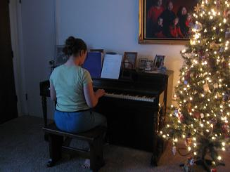 Emily's filling our home with Christmas melodies.